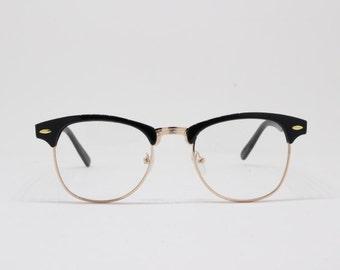 Clubmaster style glasses, black and gold browline half frame, classic vintage design spectacles. Prescription eyeglasses.