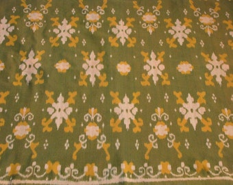 Hand woven olive green cotton Ikat fabric, by the yard