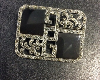 Silver deco style onyx and marcasite brooch