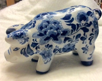 Vintage large cobalt blue Chinese ceramic pig figurine.