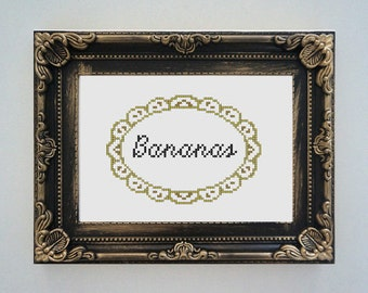 Framed 'Bananas' cross stitch