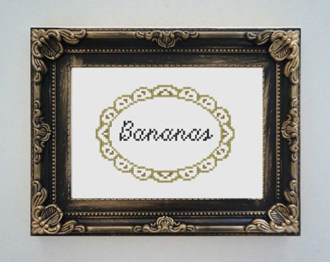 Framed 'Bananas' cross stitch