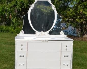 sold Dresser/Mirror  white vintage glass and brass hardware 1920'