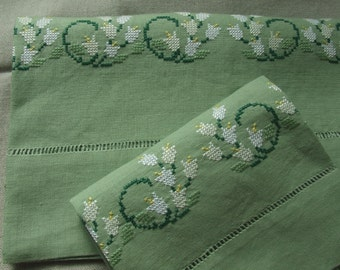 Snowdrop on pure linen. Towel, and guest. Embroidered cross-stitch