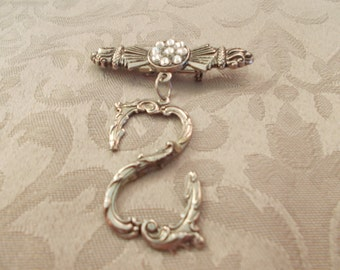 Silver Tone Infinity Ladies Pin/Pendent