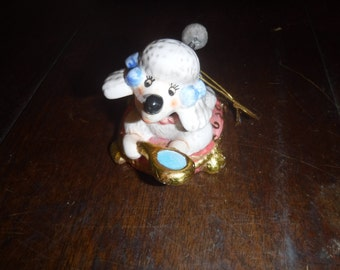 Poodle bobble head and tail drinking from his water dish christmas ornament