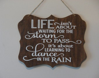 Life isn't about waiting for the storm to pass it's about learning to dance in the rain . hanging sign, Plaque, with vinyl saying