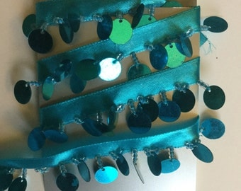 Turquoise ribbon, sequin and bead trim.