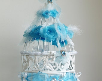 Bird cage with flowers feathers lace wedding urn ribbons and beads