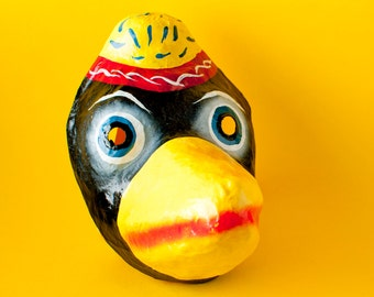 Traditional Mexican paper mache mask raven