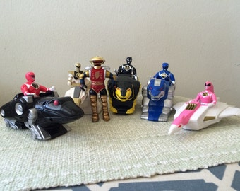 Vintage power ranger action figures with animal cars and robot