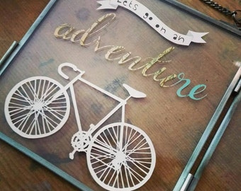 Bicycle adventure  - let's go on adventure hanging papercut sign.