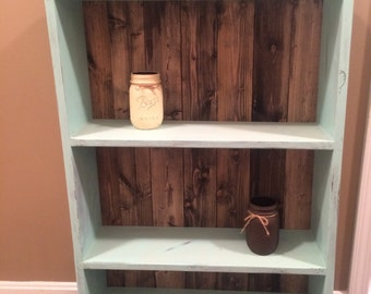 Turquoise bookshelf with barnwood effect backing distressed