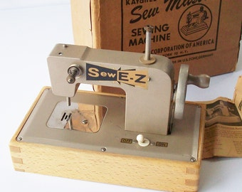 Vintage Tiny Sewing Machine / E-Z Sew / Battery Operated / Original box with Instructions.