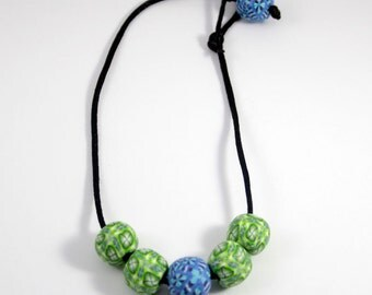 Light bead necklace. 5 blue and green balls