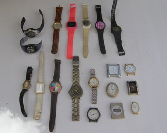Lot of 19 (500gr} old different used watches for parts only