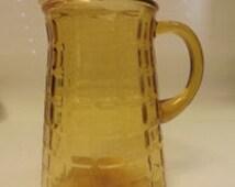 Amber waffle pattern glass pitcher 1950's