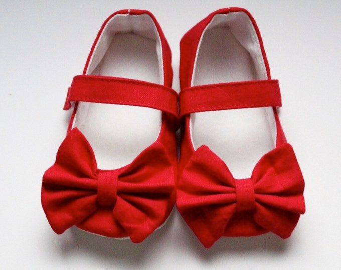 Red Mary Jane soft sole baby girl shoes, with over sized bow