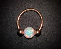 Rose gold daith piercing ring with round white opal, 16g