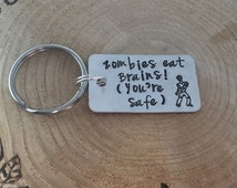 Hand Stamped Zombie Apocalypse Keyring can be personalised if preferred.