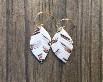 water-etched white porcelain leaf earrings with gold accent