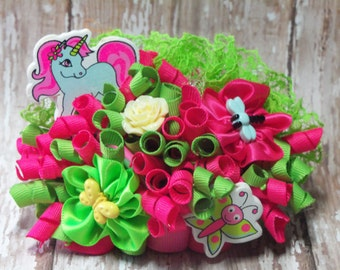 Pink and green unicorn funky loopy bow.