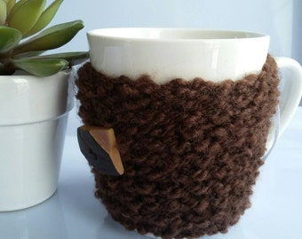 Regular coffee cup sleeve has wood vintage button