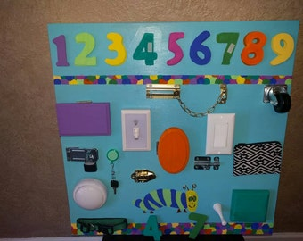 Storybook themed busy board with Velcro numbers.