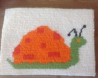 1970s Orange Snail Needlepoint