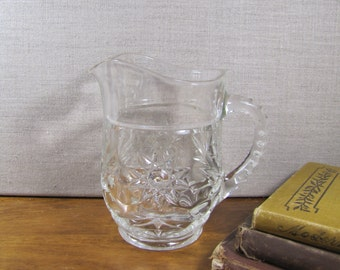 Small Pressed Glass Pitcher - Star Pattern - Notched Handle