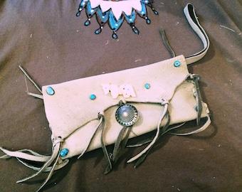 Handmade leather clutch bag