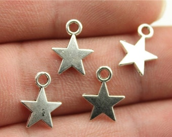 3 Tiny Star Charms in antique silver.  Wholesale charms.  Silver Charms. Wholesale Findings.  Jewelry Findings.