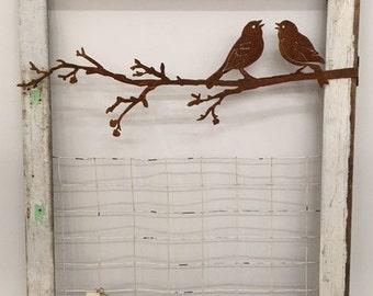 Chippy white window with rusty birds