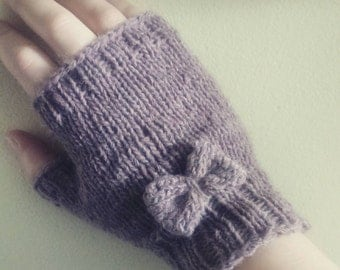 Hand knit short fingerless gloves with bow