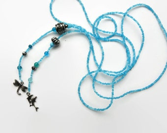 Long lariat seed bead necklace turquoise, long seed bead necklace,  seed beads, blue glass beads, Bali beads. 2 charms: dragonfly, dolphins.