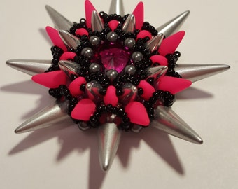 """Beaded pendant """"Embla, with Swarovski crystals and spikes, in neon pink, silver and black"""