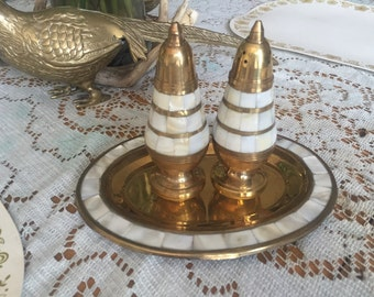 Vintage brass and mother of pearl salt-and-pepper shakers with tray