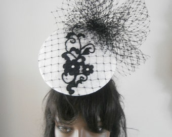white sinamay 3d perching convex disc pod,embellished with merry widow veiling and lace applique