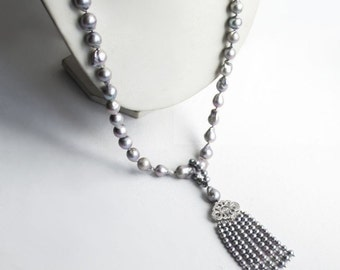 Long tassel necklace with silvery Baroque pearls