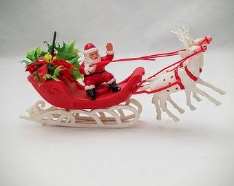 Vintage Santa on his Sleigh and Flying Reindeer Made in Hong Kong - lowered price