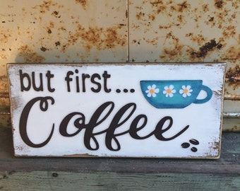 But First... Coffee - Handmade sign, frameless, weathered/distressed background, brown letters, blue cup with daisy trio & coffee beans (WH)