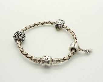 Pandora Single Woven Leather Bracelet in Champagne with Four Pandora Charms