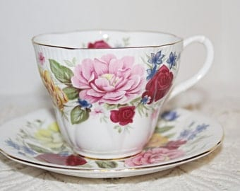 "ROYAL ALBERT ""Somerset"" Teacup and Saucer Large Full Roses Across Cup and Saucer in Red,Pink,Yellow,Blue"