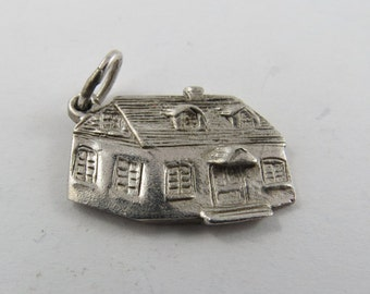 A Three Dimintional House Sterling Silver Charm.