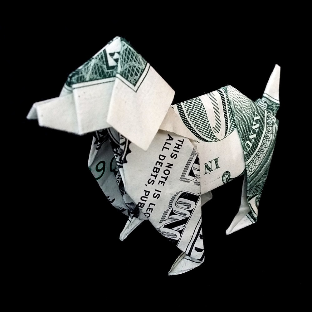 money origami dog made out of real one dollar bill