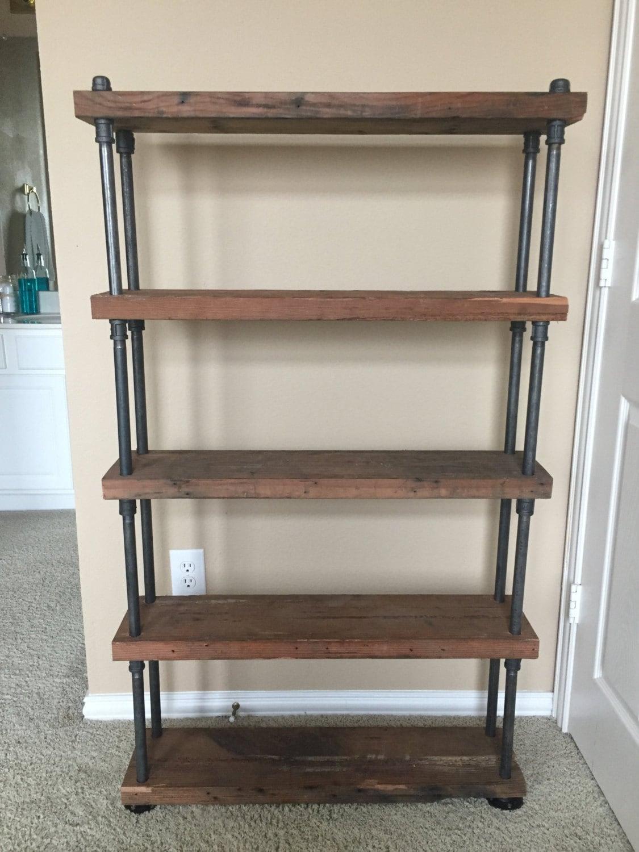 Custom reclaimed wood shelving with industrial black steel