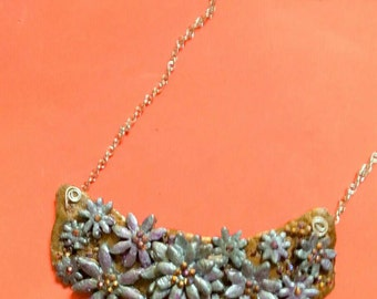 Clay daisy bib statement necklace