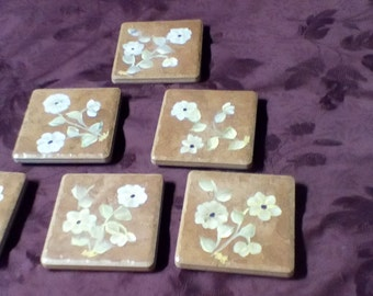 Hand painted terra cotta coasters with blue/yellow and white/yellow