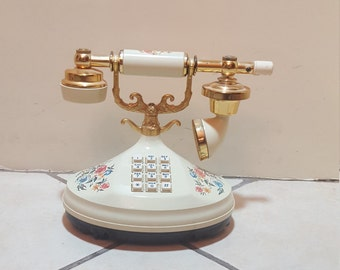 Vintage cream and gold rotary phone with flowers