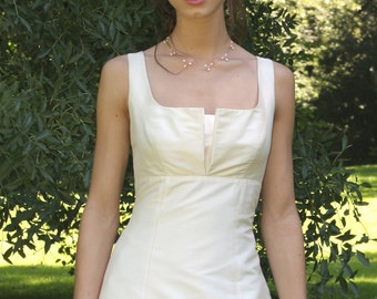 Simple cut wedding gown with pleated neckline